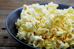 Buttered popcorn on the back bowl Stock Image