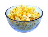 Buttered popcorn in blue bowl. A blue bowl with buttered popcorn on a white background Royalty Free Stock Image