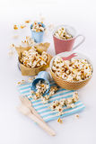 Buttered popcorn in bowls over white background Royalty Free Stock Photography