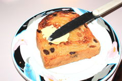 Buttered raisin toast. Toated raisin bread on plate with butter and knife Stock Photography