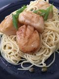 Buttered scallops pasta. With capers Stock Photo