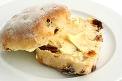 Buttered Scone. A buttered date scone on a white plate royalty free stock photo
