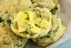 Buttered Spinach Scones. Delicious fresh baked buttered savory cheese and spinach scones ready to serve Royalty Free Stock Photo
