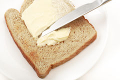 Buttered spread. Bread with delicious thick buttered spread over it Stock Image