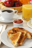 Buttered toast. A plate of buttered toast with strawberry apricot preserves on the side Stock Photography
