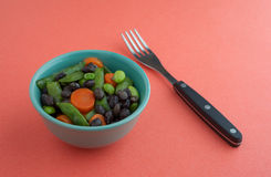 Buttered vegetables in a small bowl with fork Stock Image