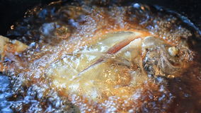Butterfish frying in hot oil. Royalty Free Stock Photography
