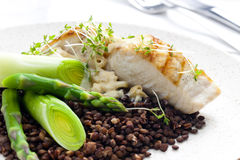 Butterfish with green lentils Stock Photo