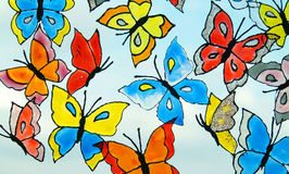 Butterflies. Many of bright, variegated butterflies on the blue skye background Royalty Free Stock Photos