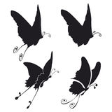 Butterflies. Four illustration of fliyng buttefly black on white Royalty Free Stock Photography