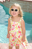 Butterflies. Adorable little blond girl smiling with sundress and matching sunglasses Stock Images