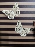 Butterflies are air in the form of earrings stock images