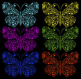 Butterflies on a black background Stock Image