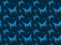 Butterflies on blue background, repeated pattern Royalty Free Stock Images