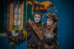 Butterflies in Burano. Masked models  of the Venetian Carnevale Royalty Free Stock Photo