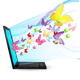 Butterflies Coming Out Of Laptop Royalty Free Stock Photo