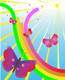 Butterflies in delight from a rainbow and the sun Stock Photos