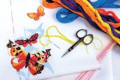 Butterflies embroidered cross-stitch. Multicolored butterflies embroidered cross-stitch Stock Image