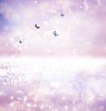 Butterflies on fantasy lake Stock Image