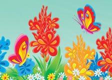 Butterflies in a flower garden Royalty Free Stock Photo