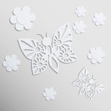 Butterflies and flowers. Paper background. Royalty Free Stock Photos