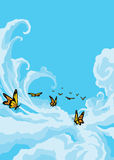 Butterflies Flying in the Blue Sky. Butterflies Flying in the Cloudy Blue Sky Royalty Free Stock Images