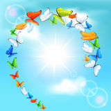 Butterflies flying in a circle Royalty Free Stock Images
