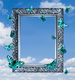 Butterflies in frame on blue sky. Royalty Free Stock Photography
