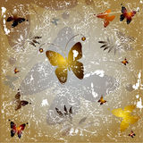 Butterflies on grey background. An illustration of a variety of butterflies and floral designs on a gray grunge background stock illustration