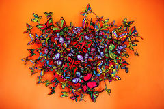 Butterflies heart shape grouping on orange background Royalty Free Stock Photography