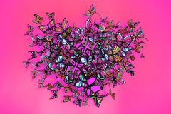 Butterflies heart shape grouping on pink background. Abstract butterflies heart shape grouping on pink background Stock Images