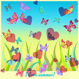 Butterflies and hearts flying over the grass.  Stock Photos