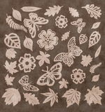 Butterflies, leaves and flowers pattern. Paper cutting. Stock Photo
