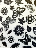 Butterflies, leaves and flowers pattern. Paper cutting. Royalty Free Stock Photo