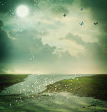 Butterflies and moon in fantasy landscape Royalty Free Stock Images