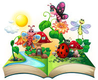 Butterflies and other insects in the book Stock Image