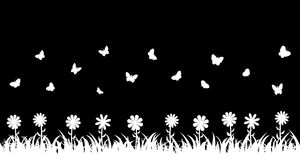 Butterflies over the grass and flowers. Stock Photo