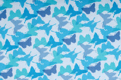 Butterflies pattern. Small blue butterfly print as background. Royalty Free Stock Photo