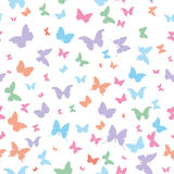 Butterflies pink lilac blue green isolated. Silhouette seamless pattern on white background. Vector illustration Royalty Free Stock Images