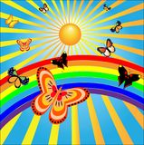 Butterflies rejoice to the sun and a rainbow Royalty Free Stock Images