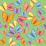 Butterflies Seamless Texture. Bright blue, green, yellow, orange and purple butterfly on a light green background for baby clothes. Seamless texture Stock Photo