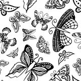 Butterflies silhouettes in hand-drawn style for tattoo design. Vector decorative doodle seamless. Stock Photos