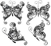 Butterflies silhouettes in tattoo style Royalty Free Stock Photography