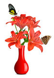 Butterflies sitting on lily in red vase Royalty Free Stock Image