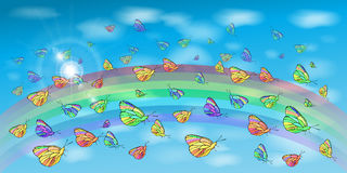 Butterflies in the sky and a rainbow Royalty Free Stock Image