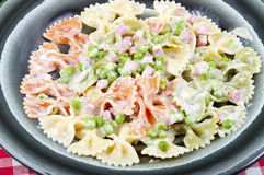 Butterflies tricolor with peas and ham. Butterflies tricolor green red and white, with ham and peas Stock Images