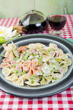 Butterflies tricolor with peas and ham. Butterflies tricolor green red and white, with ham and peas Stock Image