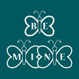 Butterflies and Valentine\'s Day. Be Mine love. Butterflies and inscription on the wings: Be Mine. Greeting card Valentine\'s Day. Design for banner, poster or Stock Photos