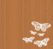 Butterflies on wood. Butterflies on a wood panel background Stock Photo