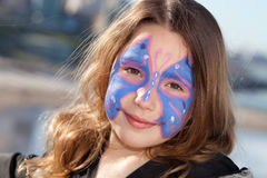 Butterfly. Cute little girl with a butterfly face paint stock photo